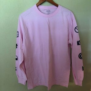 Pink men's tee shirt from Tilly's.